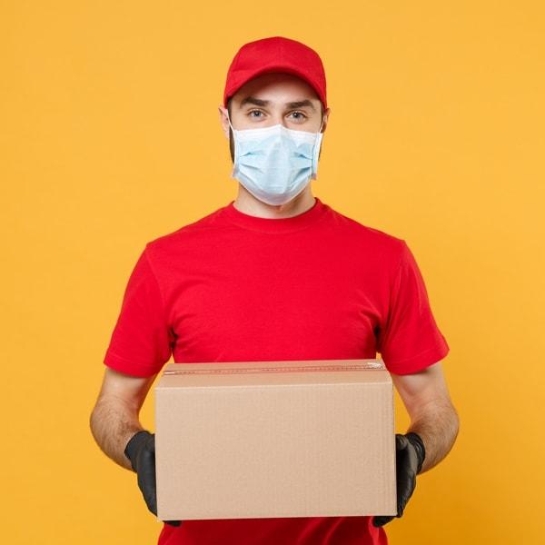 man delivering masks himself wearing a mask