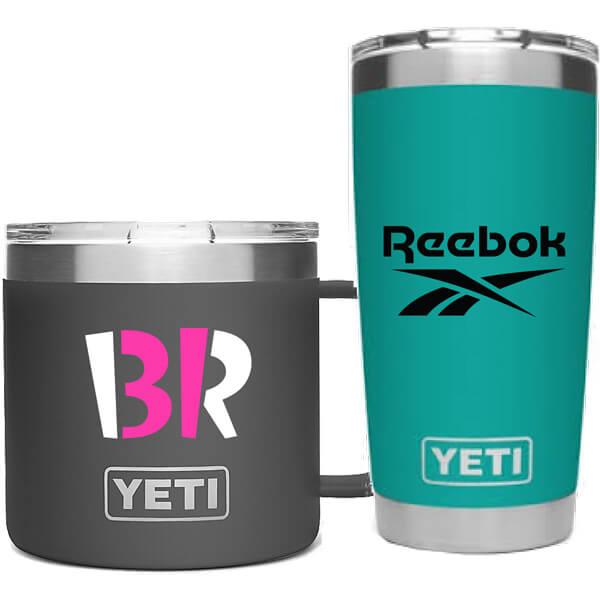 Black and teal custom Yeti mugs side by side