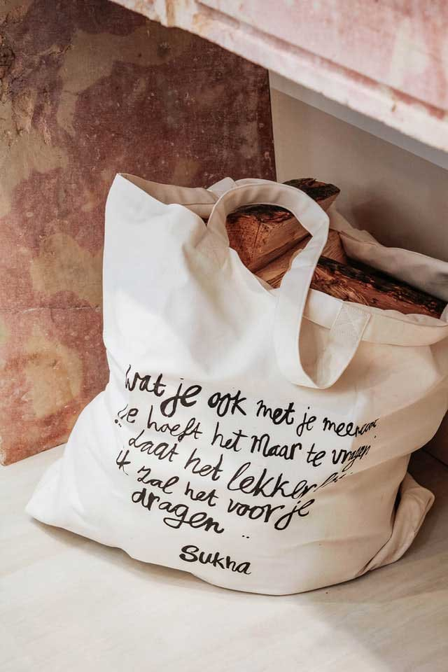 cotton tote full of firewood printed with foreign text